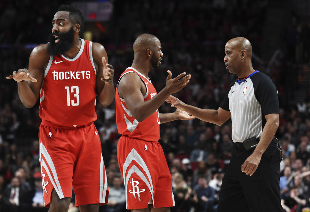 Houston Rockets guard James Harden reacts as guard Chris Paul argues a call with referee Derrick Stafford during the second half of the team's NBA basketball game against the Portland Trail Blazer ...