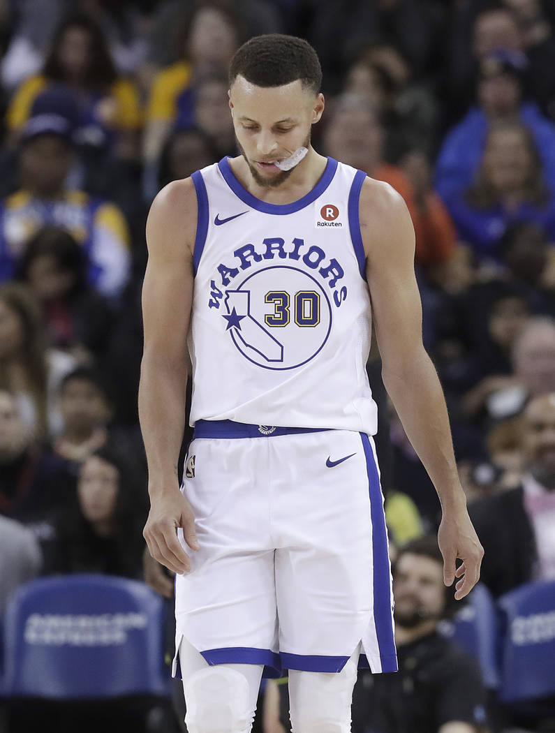 Golden State Warriors guard Stephen Curry (30) walks on the floor during the second half of the team's NBA basketball game against the Atlanta Hawks in Oakland, Calif., Friday, March 23, 2018. (AP ...