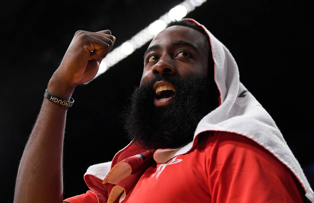 Houston Rockets guard James Harden gestures to a fan who was heckling him during the second half of the team's NBA basketball game against the Los Angeles Lakers on Tuesday, April 10, 2018, in Los ...