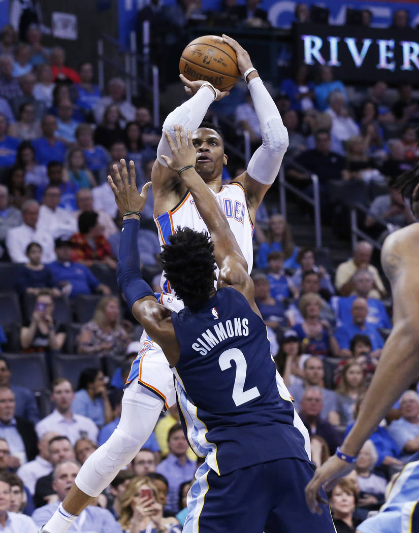 Oklahoma City Thunder guard Russell Westbrook (0) shoots over Memphis Grizzlies guard Kobi Simmons (2) in the second half of an NBA basketball game in Oklahoma City, Wednesday, April 11, 2018. (AP ...
