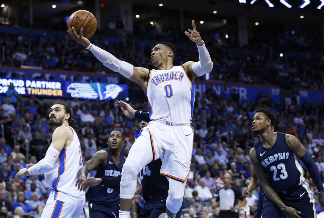 Oklahoma City Thunder guard Russell Westbrook (0) goes to the basket in front of Memphis Grizzlies guard Mario Chalmers (6), forward Dillon Brooks (24) and guard Ben McLemore (23) in the second ha ...