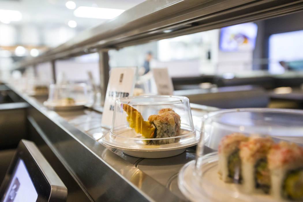 A lobster roll passes by on the conveyor belt at Sapporo Revolving Sushi in Las Vegas on Wednesday, April 25, 2018. Chase Stevens Las Vegas Review-Journal @csstevensphoto