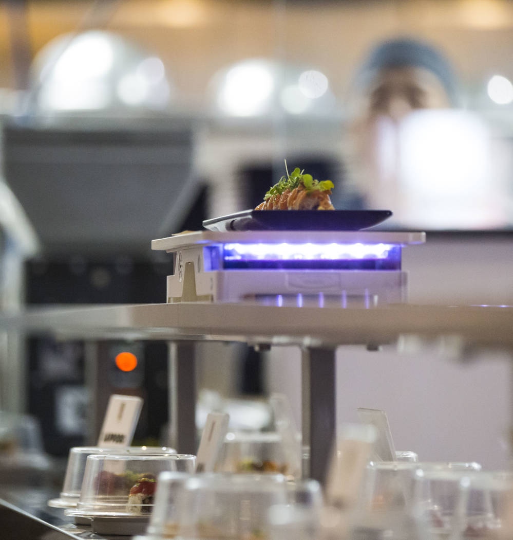 A Sapporo garlic salmon roll arrives via a robotic cart at Sapporo Revolving Sushi in Las Vegas on Wednesday, April 25, 2018. Chase Stevens Las Vegas Review-Journal @csstevensphoto