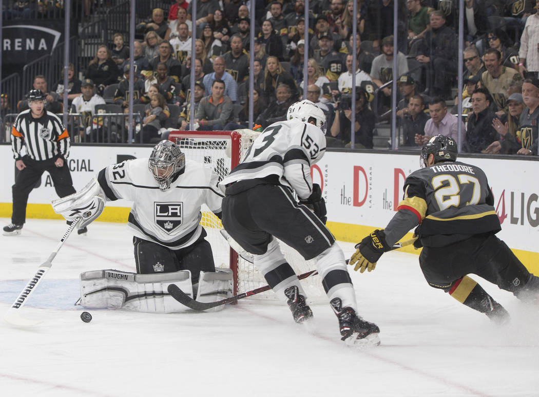 Golden Knights defenseman Shea Theodore (27) shoots against Los Angeles Kings goaltender Jonathan Quick (32) in the first period of game two of their first-round playoff series on Friday, April ...