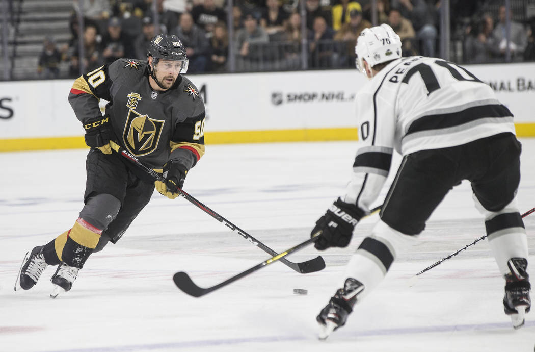 Golden Knights left wing Tomas Tatar (90) moves the puck up ice against Los Angeles Kings left wing Tanner Pearson (70) in the first period of game two of their first-round playoff series on Frida ...
