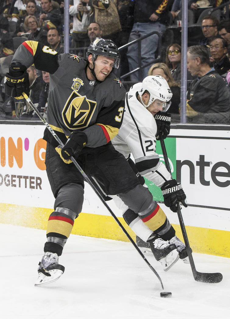 Golden Knights defenseman Brayden McNabb (3) fights for a puck with Los Angeles Kings right wing Dustin Brown (23) during the second period of game two of their first-round playoff series on Frida ...