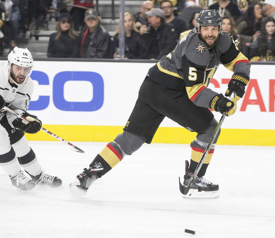 Golden Knights defenseman Deryk Engelland (5) knocks the puck away from a Los Angeles player in the second period of game two of their first-round playoff series on Friday, April 13, 2018, at T-Mo ...