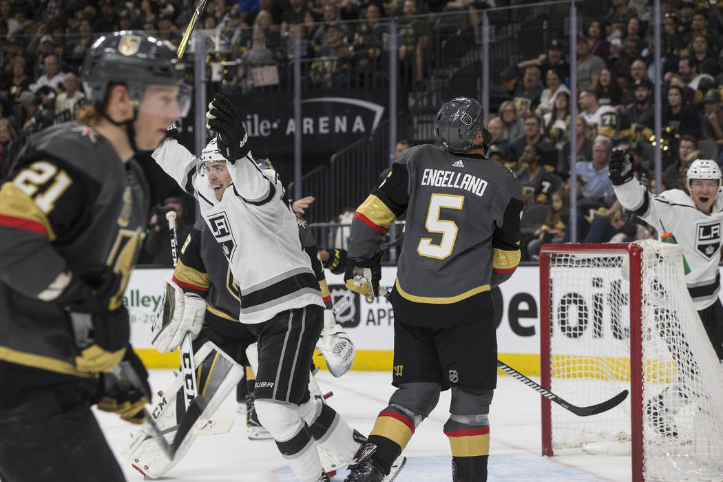 Los Angeles Kings left wing Tanner Pearson (70) celebrates after teammate Paul LaDue (38) scores a second-period goal during game two of their first-round playoff series with the Golden Knights on ...