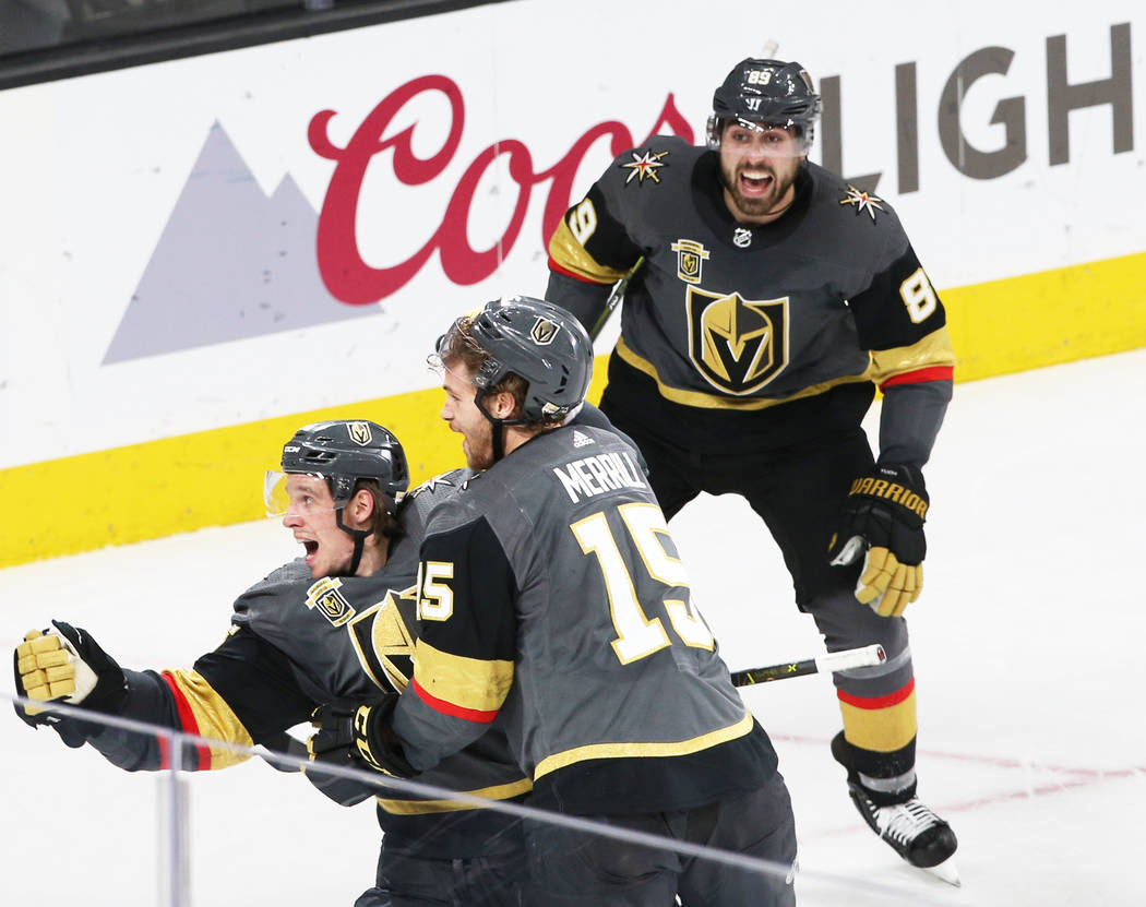 Golden Knights left wing Erik Haula (56) celebrates with teammate Jon Merrill (15) after scoring the game winning goal in double-overtime to win game two of their first-round playoff series on Fri ...