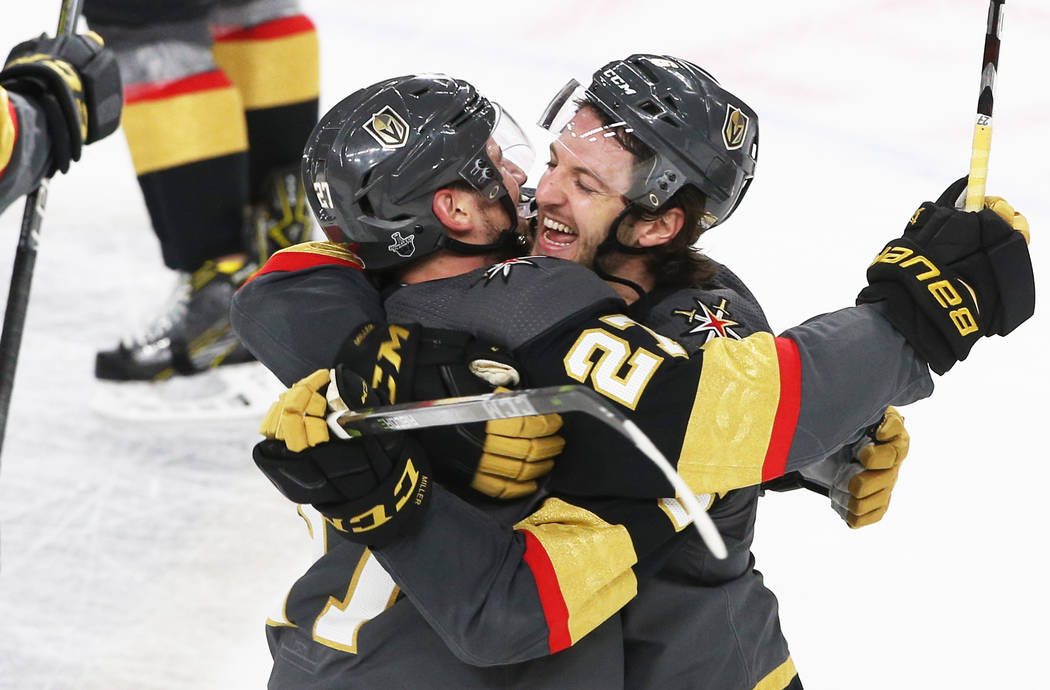 Golden Knights left wing Erik Haula (56) celebrates with teammate Shea Theodore (27) after scoring the game winning goal in double-overtime to win game two of their first-round playoff series on F ...