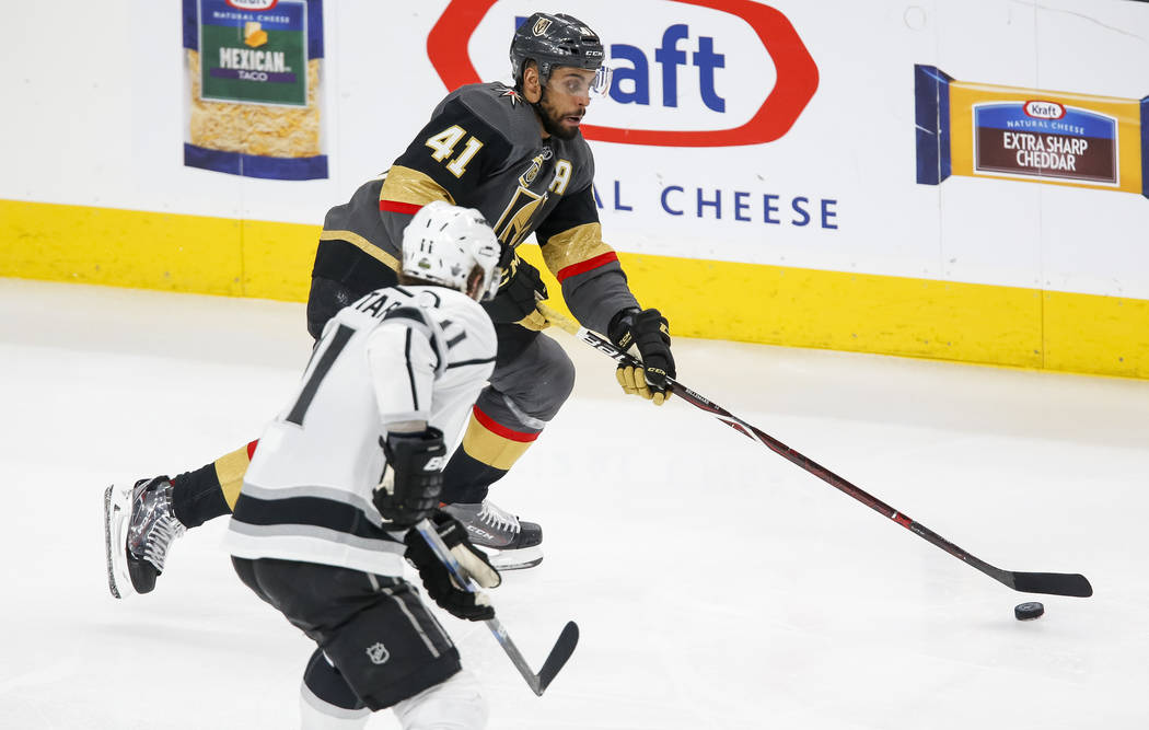 Golden Knights left wing Pierre-Edouard Bellemare (41) controls the puck as Los Angeles Kings center Anze Kopitar (11) approaches during the second period of Game 2 of an NHL hockey first-round pl ...