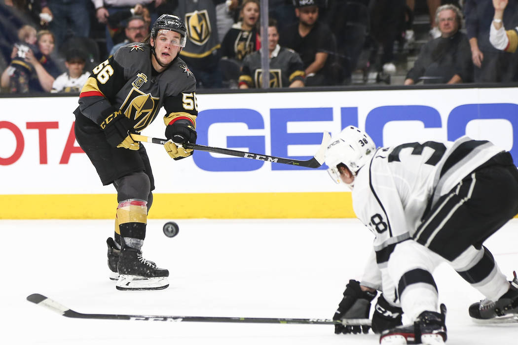 Golden Knights left wing Erik Haula (56) sends the puck past Los Angeles Kings defenseman Paul LaDue (38) during the third period of Game 1 of an NHL hockey first-round playoff series at T-Mobile ...