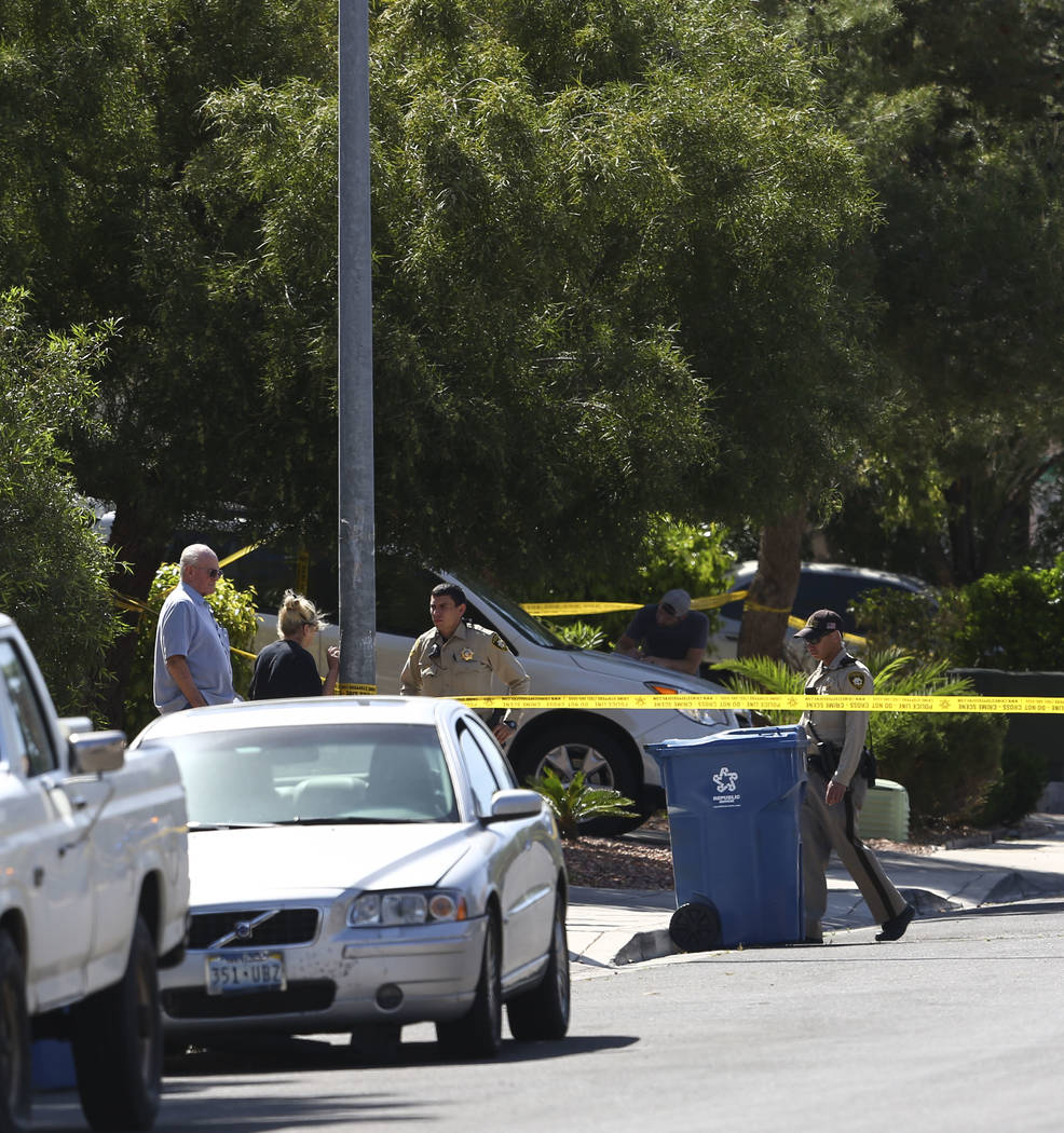 Las Vegas police investigate the scene of a shooting on the 9800 block of Pioner Avenue, near near West Desert Inn Road and South Hualapai Way, in Las Vegas on Friday, April 13, 2018. The victim w ...