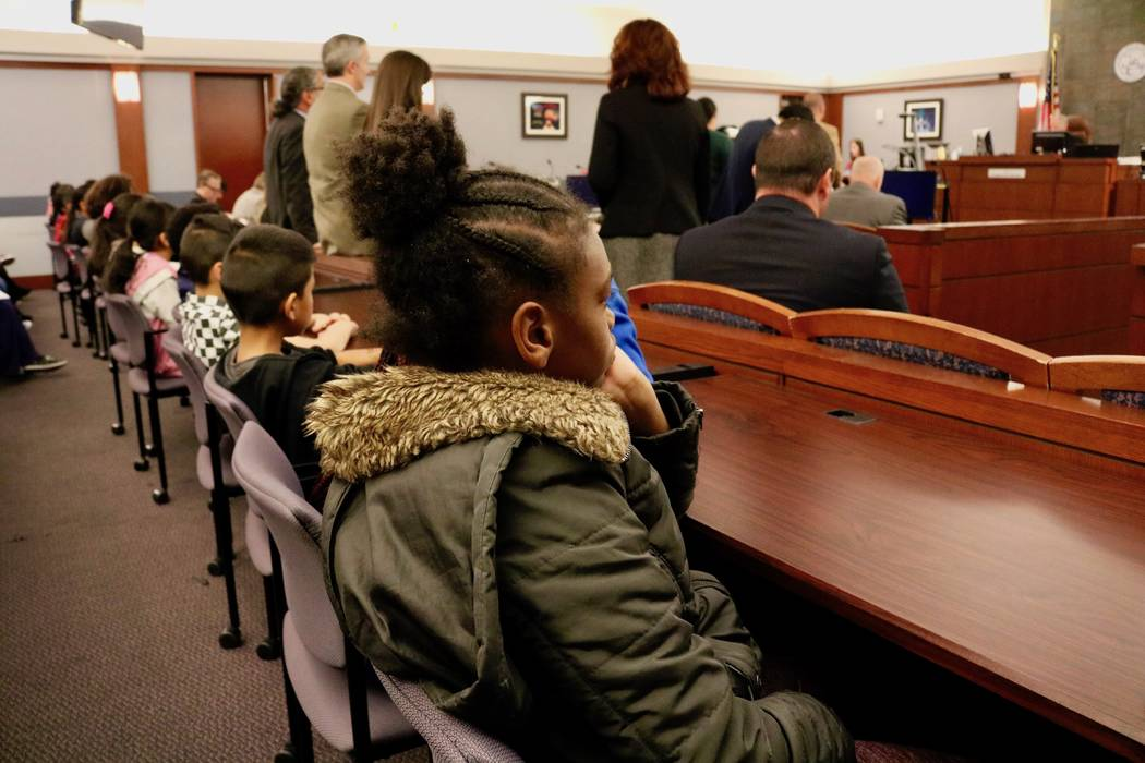 Kyennedy Adams, 10, listens to a criminal calendar in Courtroom 15D of the Regional Justic Center in Las Vegas, Friday, April 13, 2018. Madelyn Reese/Las Vegas Review-Journal