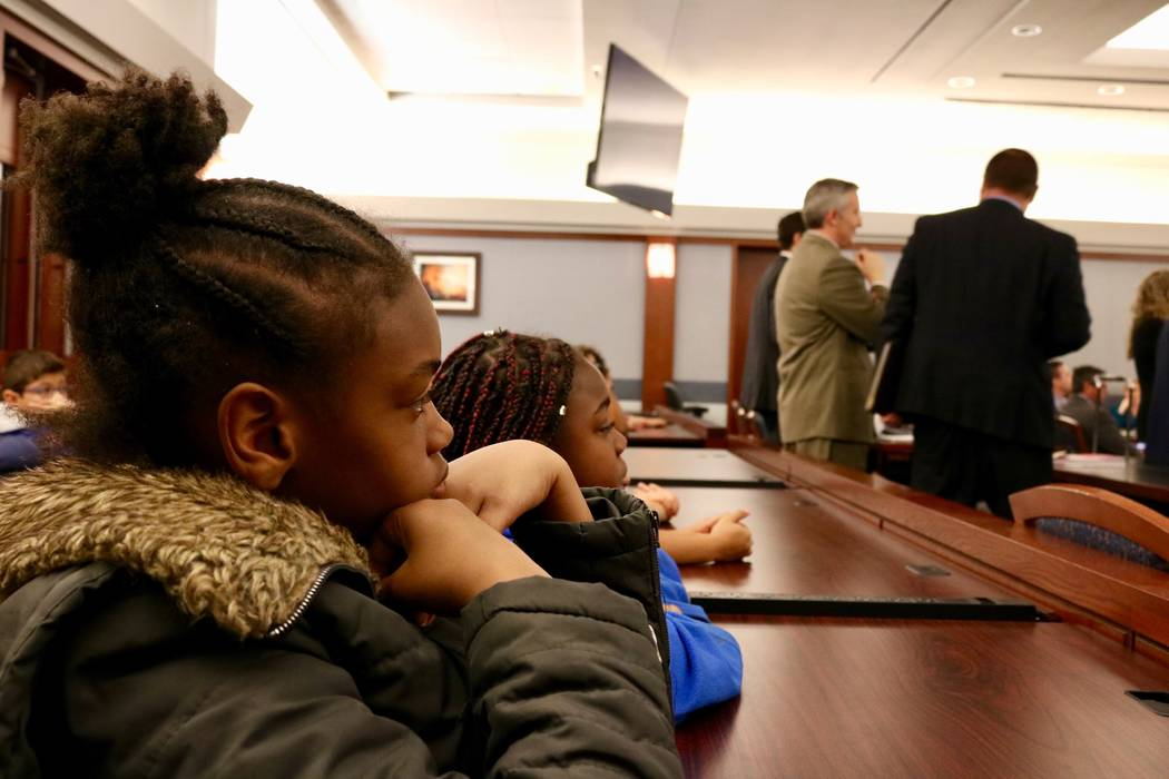 Kyennedy Adams, 10 and Elilia Arceneaux, 10, listene to a criminal calendar in Courtroom 15D of the Regional Justice Center in Las Vegas, Friday, April 13, 2018. Madelyn Reese/Las Vegas Review-Journal