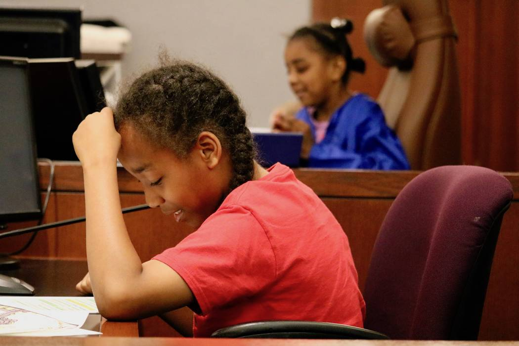 Taliyah Crowder, 10, plays the part of Hagrid in a mock trial in Courtroom 15D of the Regional Justice Center in Las Vegas, Friday, April 13, 2018. Madelyn Reese/Las Vegas Review-Journal