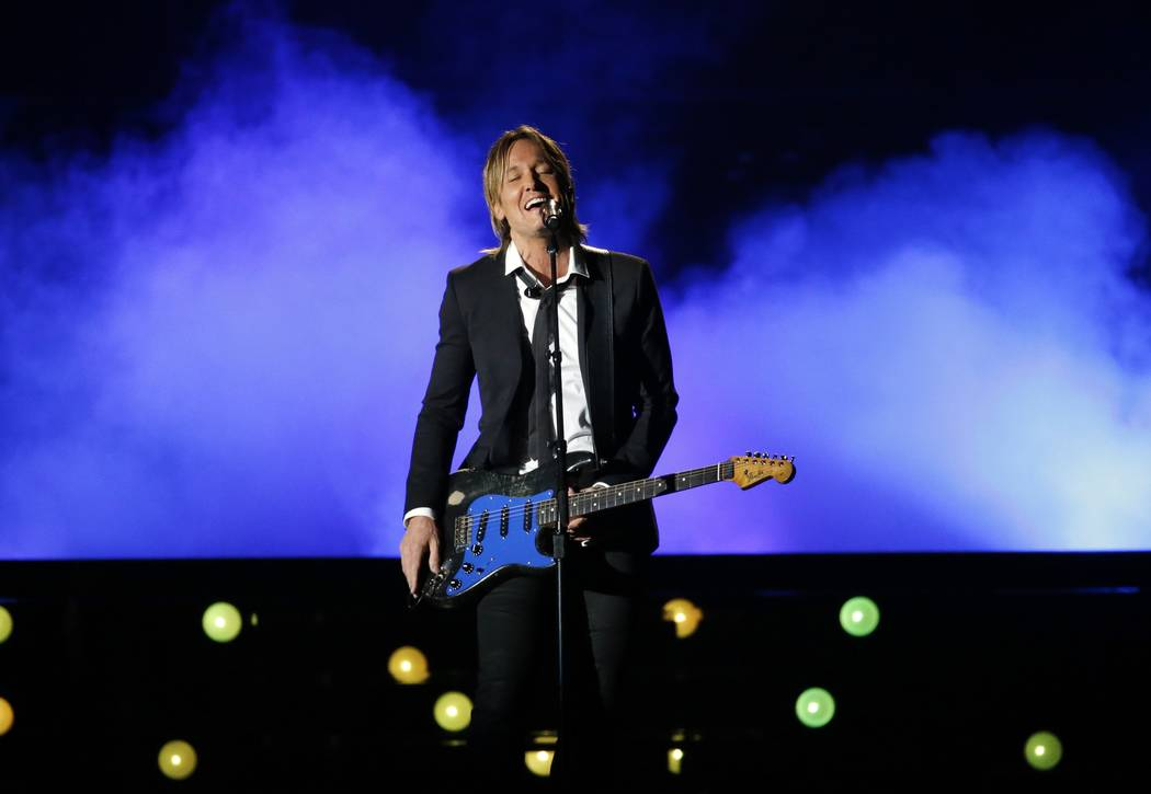 "52nd Academy of Country Music Awards - Show - Las Vegas, Nevada, U.S., - 02/04/2017 - Musician Keith Urban performs ""Blue Ain't Your Color"". REUTERS/Mario Anzuoni"