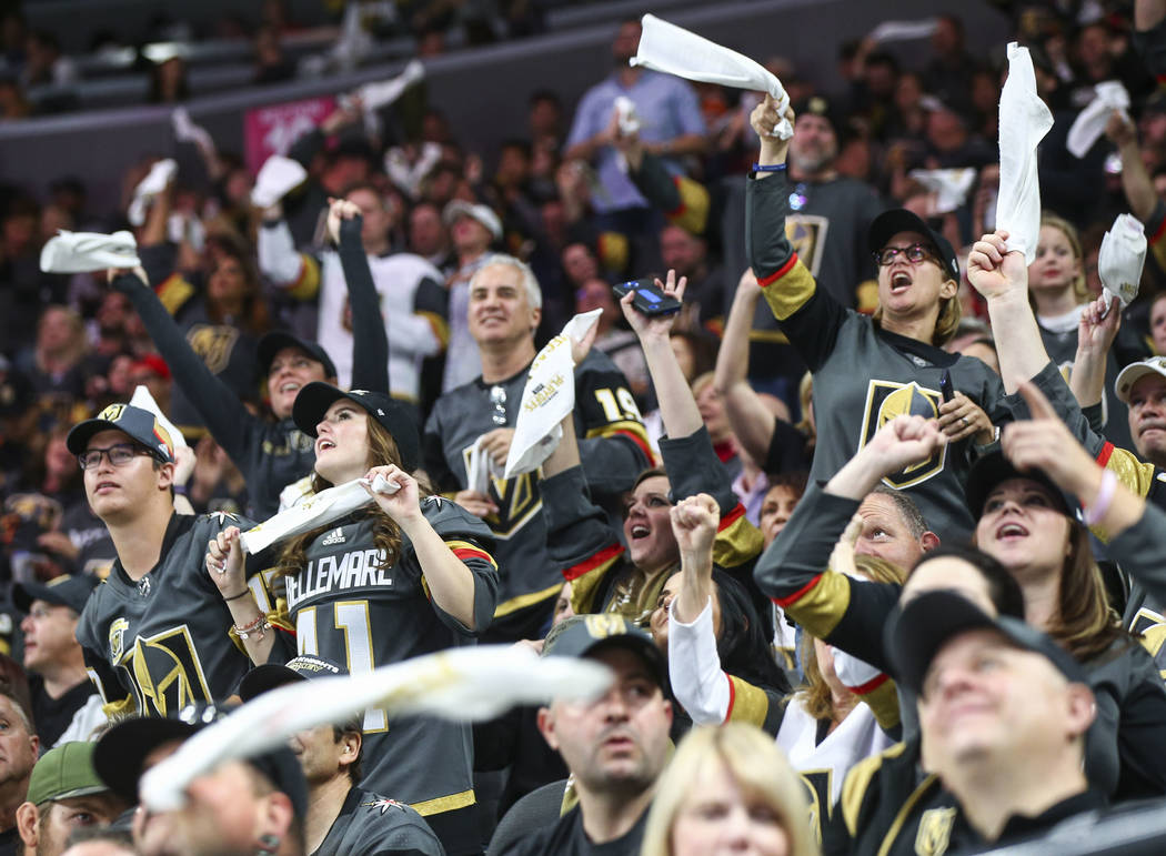 Golden Knights fans cheer during the third period of Game 1 of an NHL hockey first-round playoff series against the Los Angeles Kings at T-Mobile Arena in Las Vegas on Wednesday, April 11, 2018. C ...
