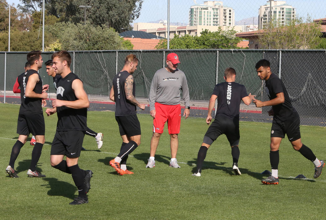 Rich Ryerson, UNLV soccer head coach, center, watches as his players warm up during team practice on Wednesday, April 18, 2018, in Las Vegas. Bizuayehu Tesfaye/Las Vegas Review-Journal @bizutesfaye