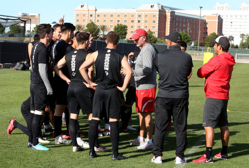 Rich Ryerson, UNLV soccer head coach, third right, talks to his players as assistant coaches Frank D'Amelio, second right, and Camilio Valencia, look on during team practice on Wednesday, April 18 ...