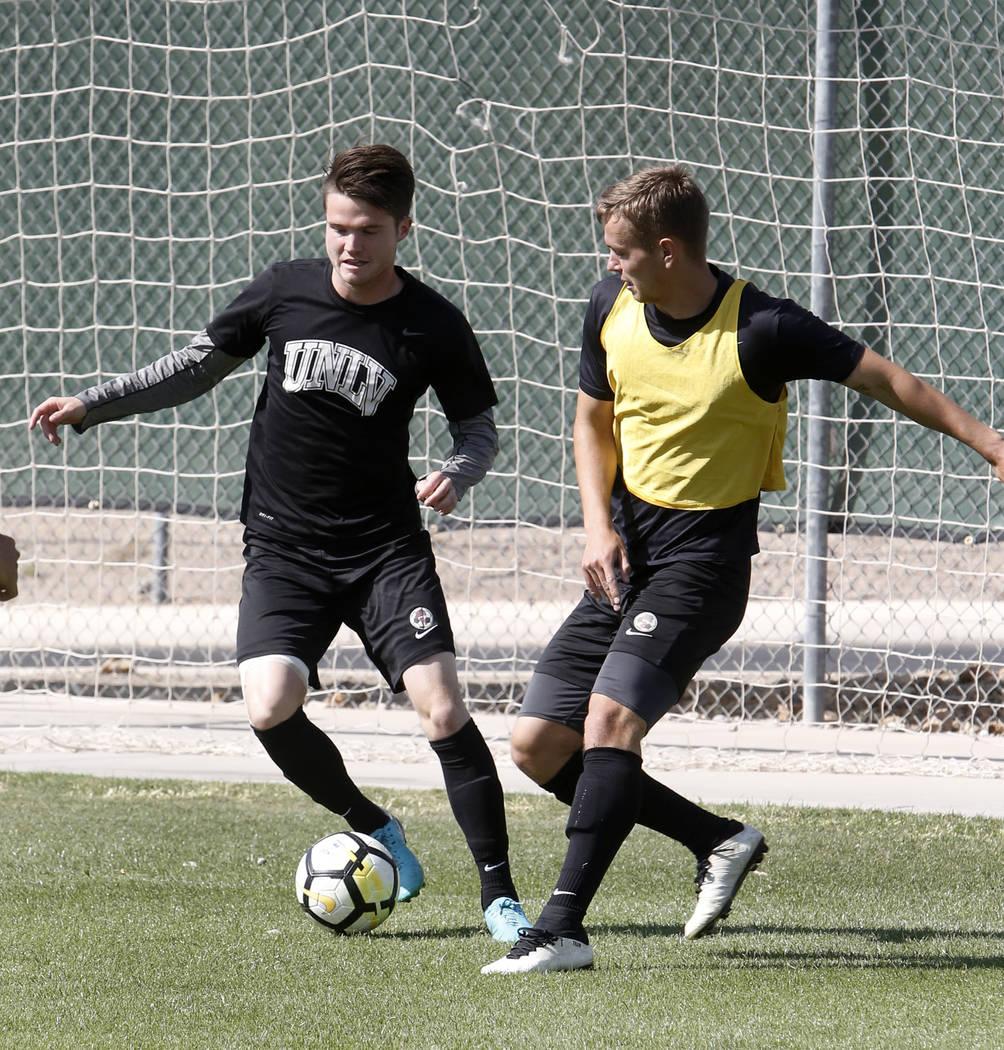 UNLV soccer midfielder Austin Manthey, center, dribbles the ball during team practice on Wednesday, April 18, 2018, in Las Vegas. Bizuayehu Tesfaye/Las Vegas Review-Journal @bizutesfaye