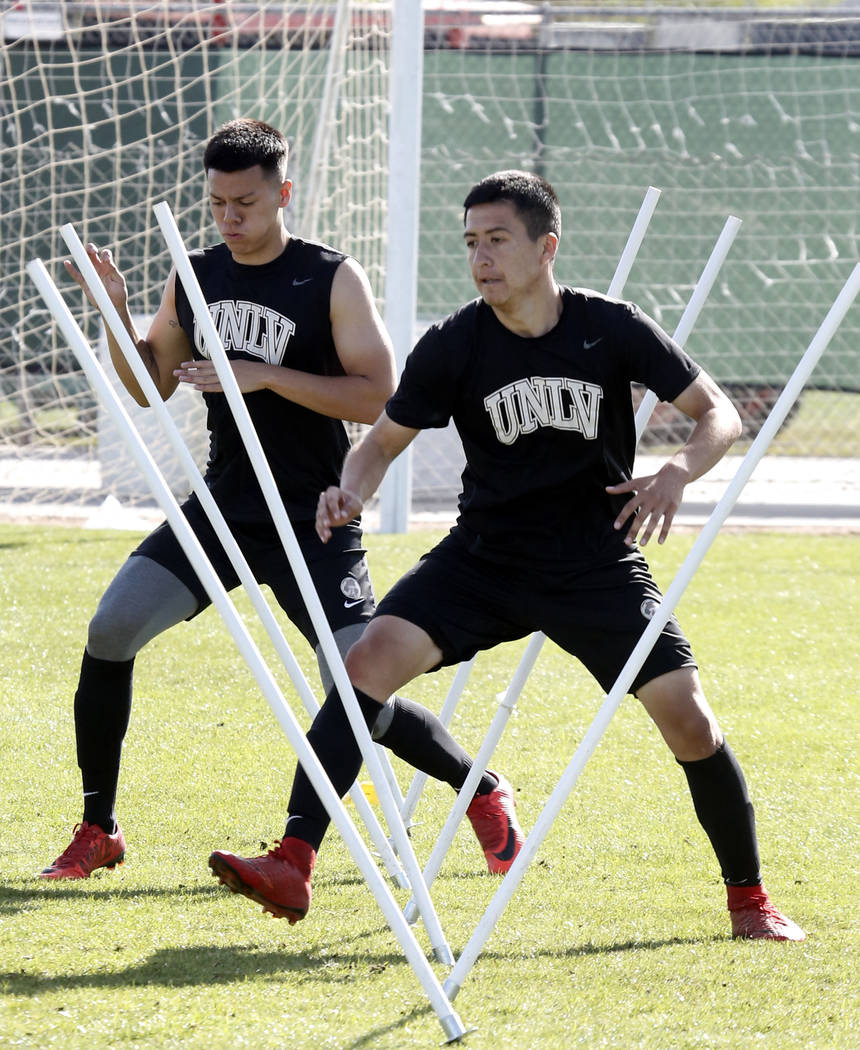 UNLV soccer midfielder Marco Gonzalez, right, and defender Ivan Farias run a drill during team practice on Wednesday, April 18, 2018, in Las Vegas. Bizuayehu Tesfaye/Las Vegas Review-Journal @biz ...