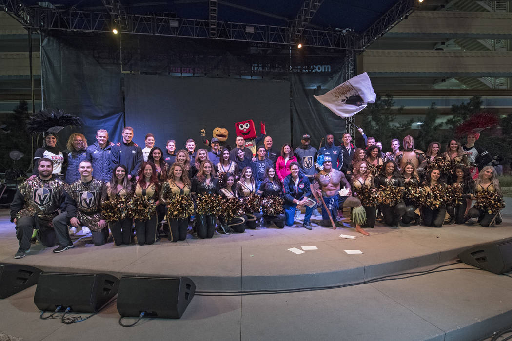 Representatives from USA Sevens rugby, UFC, Vegas Golden Knights and NASCAR pose for a group photo during the Ultimate Vegas Sports Weekend pep rally at Toshiba Plaza Wednesday, February 28, 2018. ...