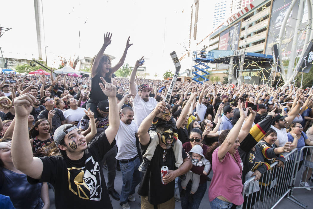 Fans cheer for rapper Logic outside T-Mobile Arena before the start of the Golden Knights first round playoff game with the Los Angeles Kings at Toshiba Plaza on Wednesday, April 11, 2018, in Las ...