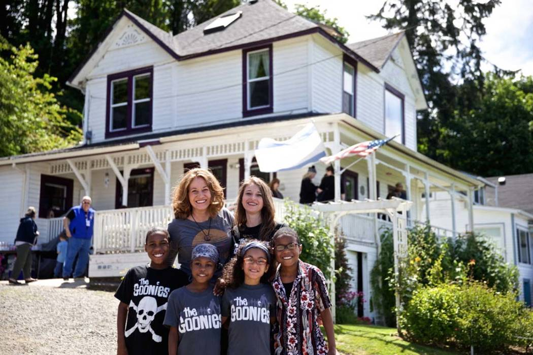 """This June, 2014, file photo shows some of the Hart family at the annual celebration of """"The Goonies"""" movie in Astoria, Ore. The SUV carrying their large family from Washington state accelerated st ..."""