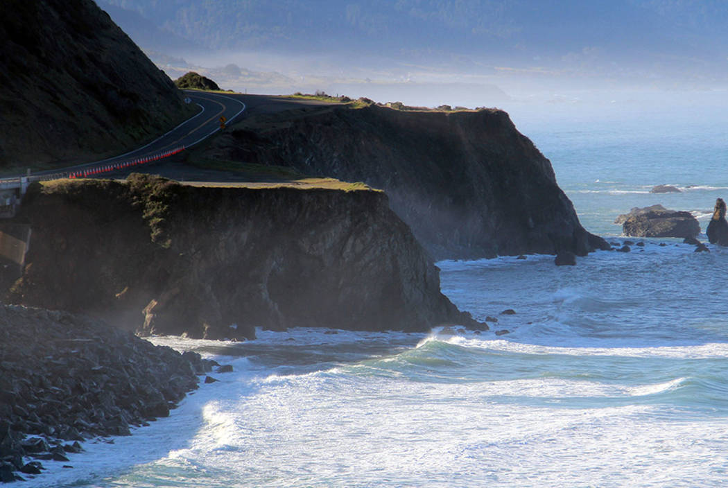Authorities work the scene of the March 26 fatal crash on the Mendocino coast near Mendocino, Calif., where the SUV carrying the Hart family off a cliff, killing all passengers. (Kale Williams/The ...