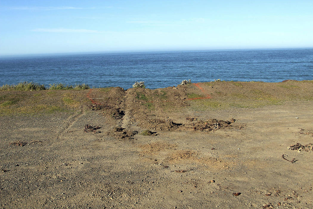 This photo shows ruts cut into the clifftop Thursday, March 29, 2018, where the SUV of Jennifer and Sarah Hart that went off the cliff was hauled up and over by a tow truck Monday off the Pacific ...