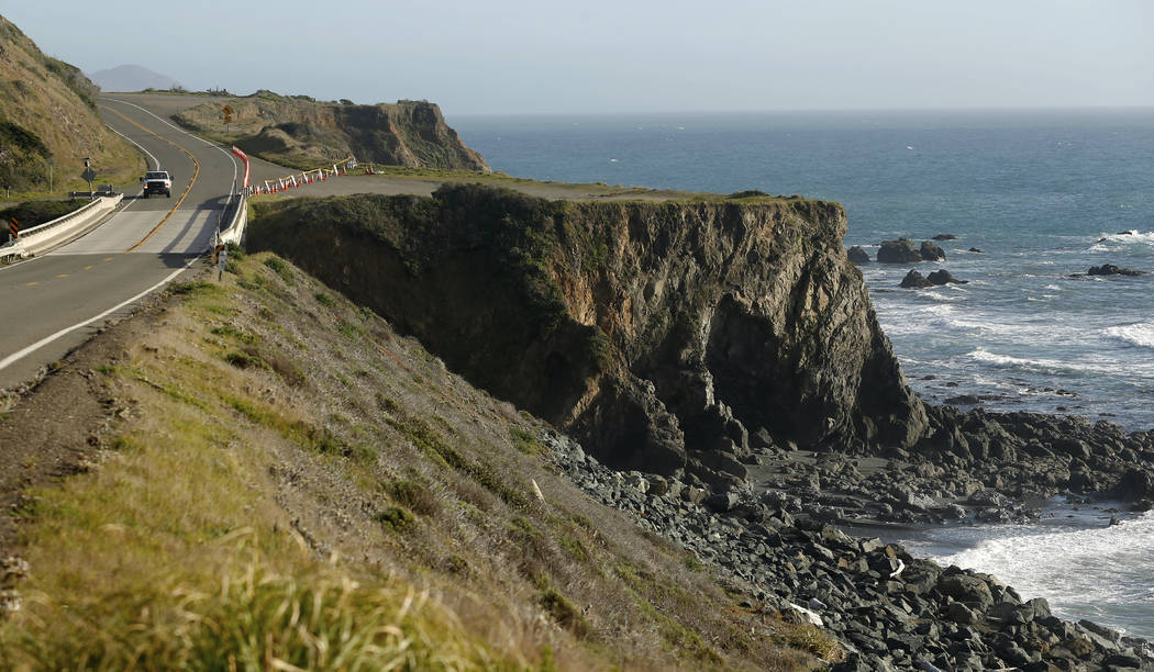 A truck drives by the pullout where the SUV of Jennifer and Sarah Hart was recovered off the Pacific Coast Highway, near Westport, Calif., Wednesday, March 28, 2018. (Alvin Jornada/The Press Democ ...