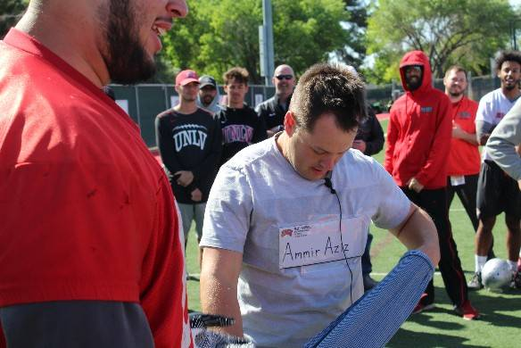 The envelope with UNLV senior defensive tackle Ammir Aziz's scholarship is taped to performer Farrell Dillon's chest. It was part of a ruse to inform Aziz of the news. Photo courtesy of UNLV Athle ...