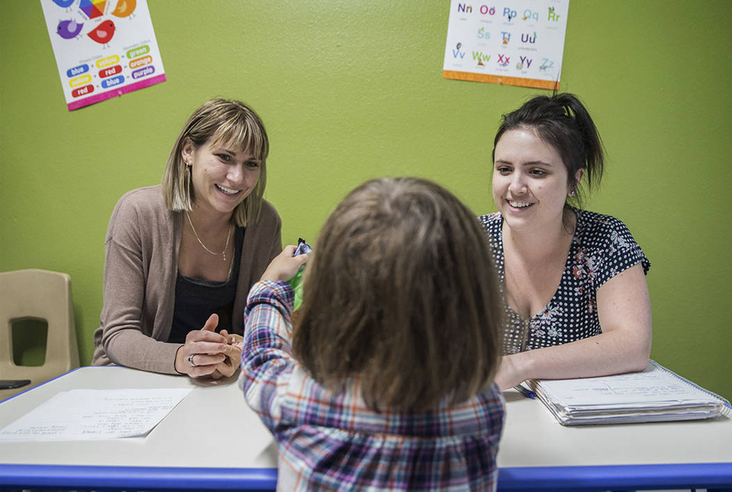 Nevada State College students Kaitlyn Nanni, left, and Makayla Nichols lead a speech therapy session on Tuesday, April 17, 2018, at RiteCare Clinic, in Las Vegas. Benjamin Hager Las Vegas Review-J ...