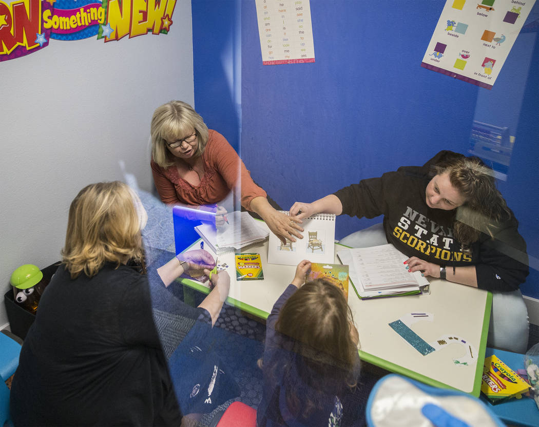 Lori Brown, top left, and Nevada State College student Jennifer Johnson lead a speech therapy session on Tuesday, April 17, 2018, at the RiteCare Clinic in Las Vegas. Benjamin Hager Las Vegas Revi ...