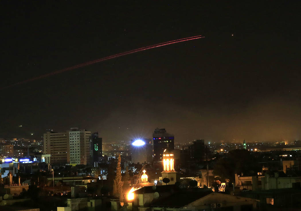 Damascus skies erupt with anti-aircraft fire as the U.S. launches an attack on Syria targeting different parts of the Syrian capital Damascus, Syria, early Saturday, April 14, 2018. (AP Photo/Hass ...