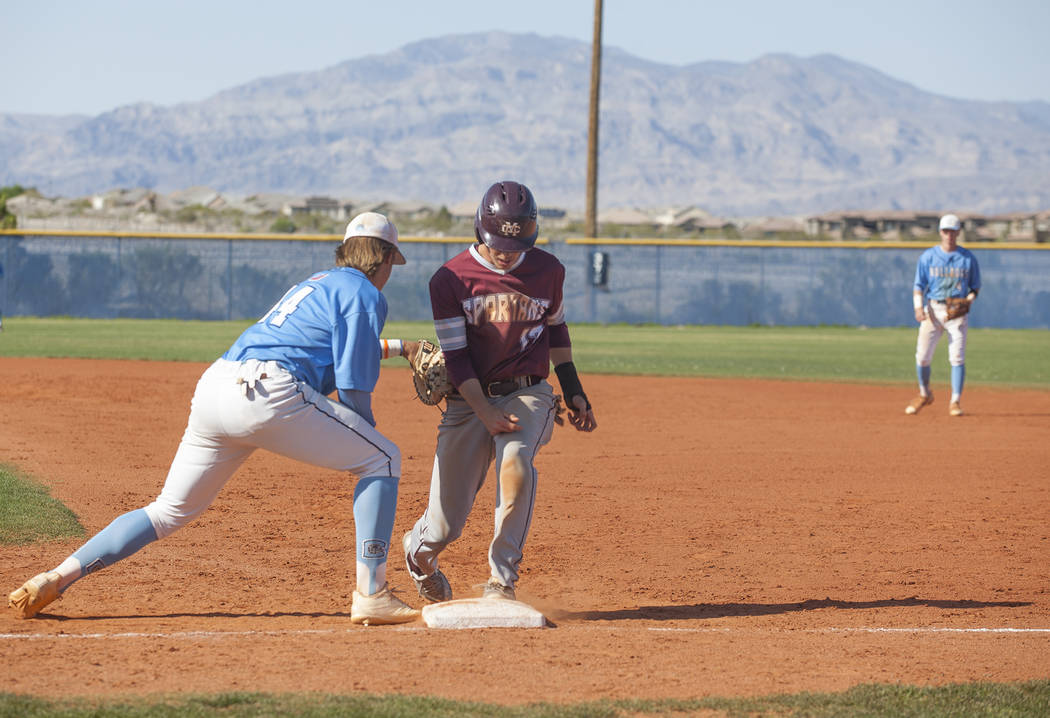 Centennial High School's Kris Bow (44) tries to tag out Cimarron-Memorial High School's Trevor Doyle (17) in a game at Centennial High School in Las Vegas, Friday, April 13, 2018. Rachel Aston Las ...