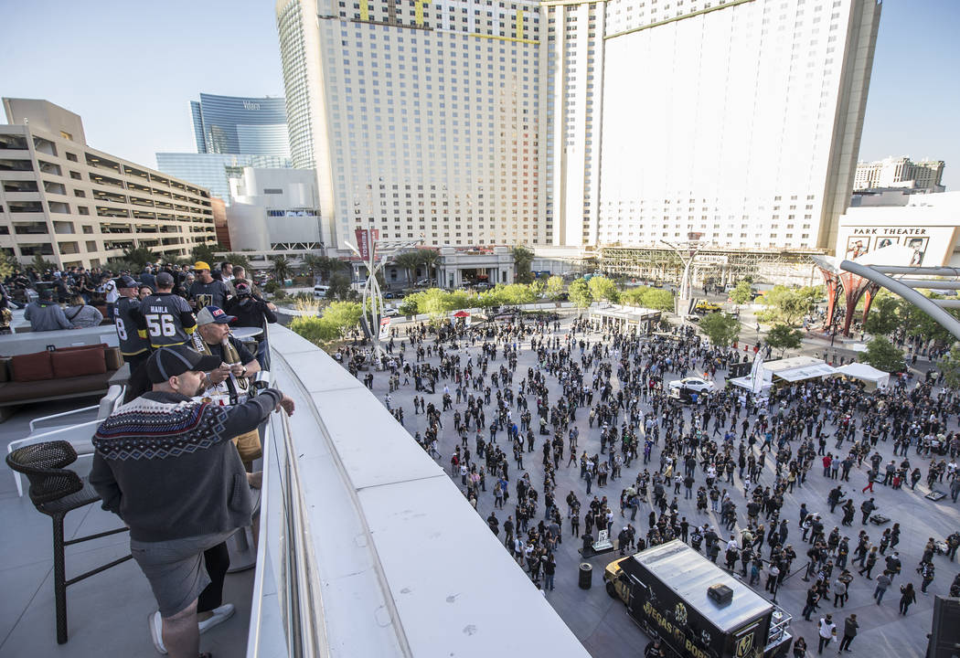 Fans gather on the patio outside T-Mobile Arena before the start of game two of the Golden Knights first round playoff series with the Los Angeles Kings at Toshiba Plaza on Friday, April 13, 2018, ...