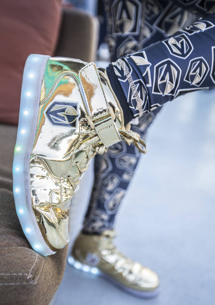 """Maria Wong's handmade """"Golden Knights"""" sneakers on the patio at T-Mobile Arena before the start of game two of the Golden Knights first round playoff series with the Los Angeles Kings at ..."""