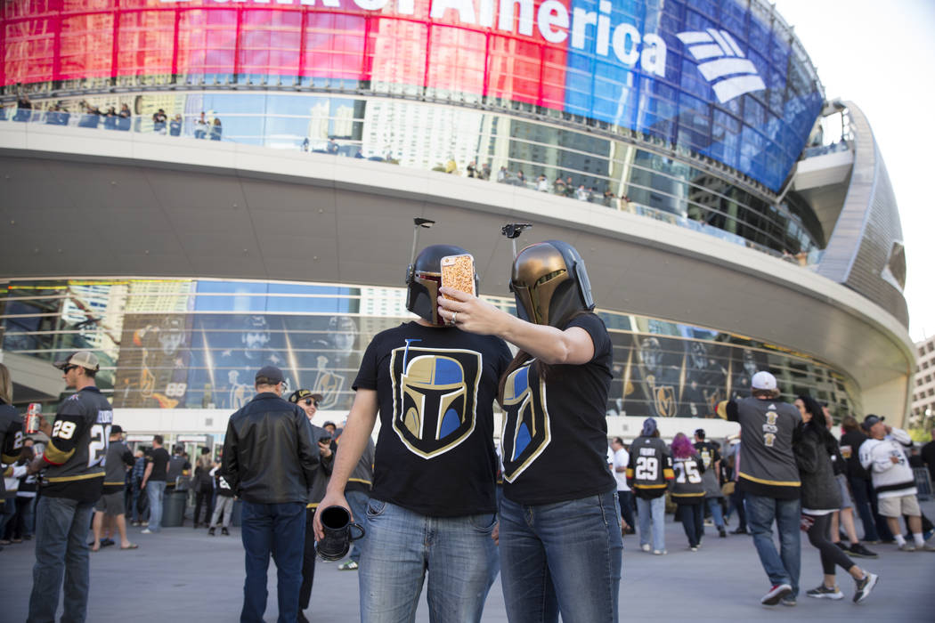 Vincent Cortez, left, with his wife Megan takes a photo together at Toshiba Plaza before the Vegas Golden Knights playoff game against the Los Angeles Kinds in Las Vegas, Friday, April 13, 2018. ...