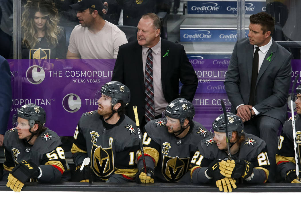 Golden Knights head coach Gerard Gallant, top center, reacts to a play during the third period of Game 2 of an NHL hockey first-round playoff series between the Golden Knights and the Los Angeles ...