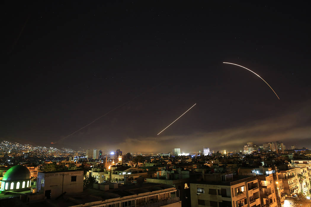 Missiles streak across the Damascus skyline as the U.S. launches an attack on Syria targeting different parts of the capital, early Saturday, April 14, 2018. Syria's capital has been rocked by lou ...