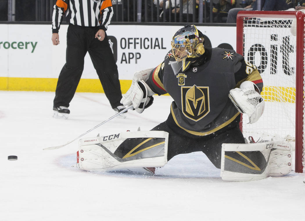 Golden Knights goaltender Marc-Andre Fleury (29) makes a save in the second period of game two of their first-round playoff series with Los Angeles on Friday, April 13, 2018, at T-Mobile Arena, in ...