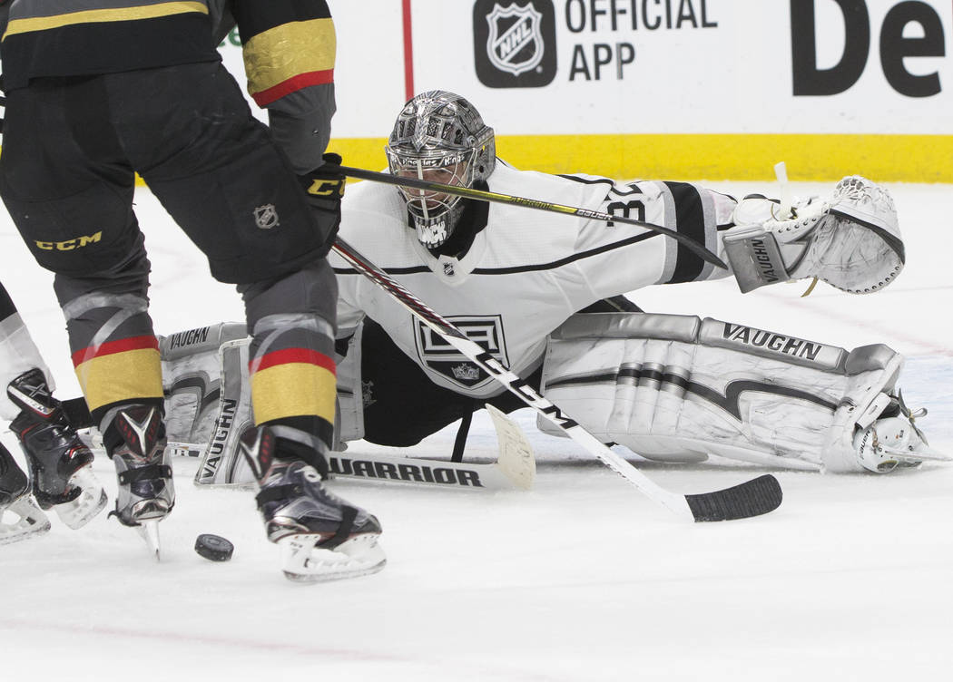 Los Angeles Kings goaltender Jonathan Quick (32) makes a save in the third period of game two of their first-round playoff series on Friday, April 13, 2018, at T-Mobile Arena, in Las Vegas. Benjam ...