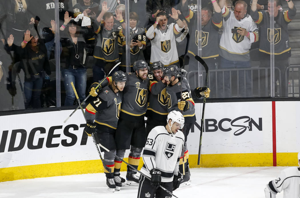 The Vegas Golden Knights celebrate a first period goal by Knights right wing Alex Tuch (89) in Game 2 of an NHL hockey first-round playoff series between the Golden Knights and the Los Angeles Kin ...