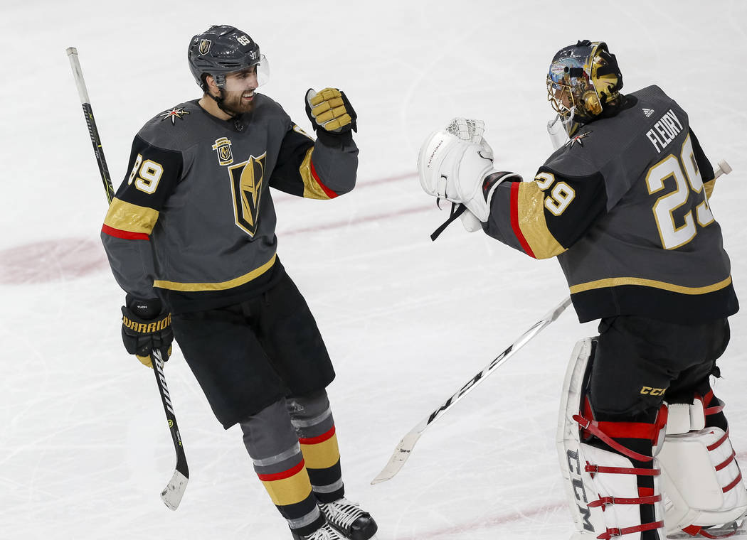 Golden Knights right wing Alex Tuch (89) celebrates a first period goal with goaltender Marc-Andre Fleury (29) during Game 2 of an NHL hockey first-round playoff series between the Golden Knights ...