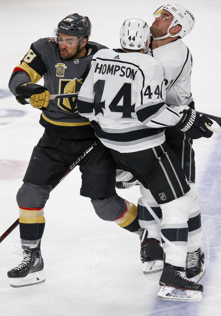 Golden Knights left wing William Carrier, left, collides with Los Angeles Kings center Nate Thompson (44) and defenseman Alec Martinez (27) during the second period of Game 2 of an NHL hockey firs ...