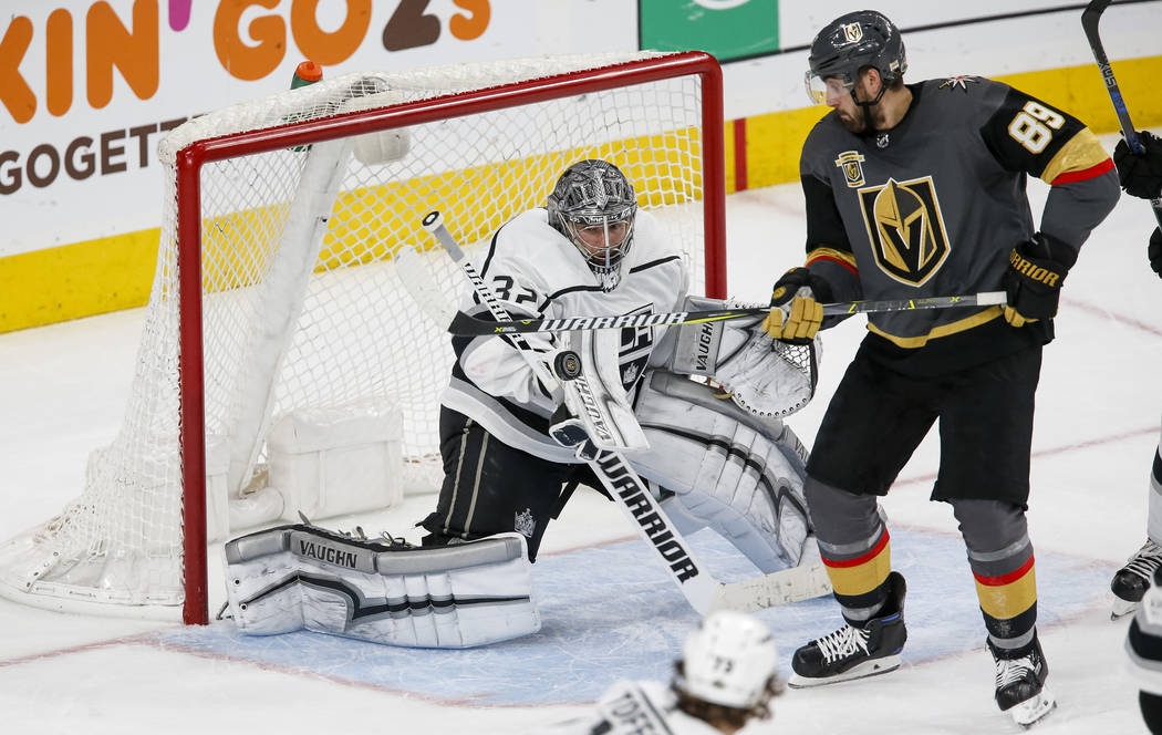Los Angeles Kings goaltender Jonathan Quick (32) blocks a shot on goal as Golden Knights right wing Alex Tuch (89) looks for the reboundsduring the third period of Game 2 of an NHL hockey first-ro ...