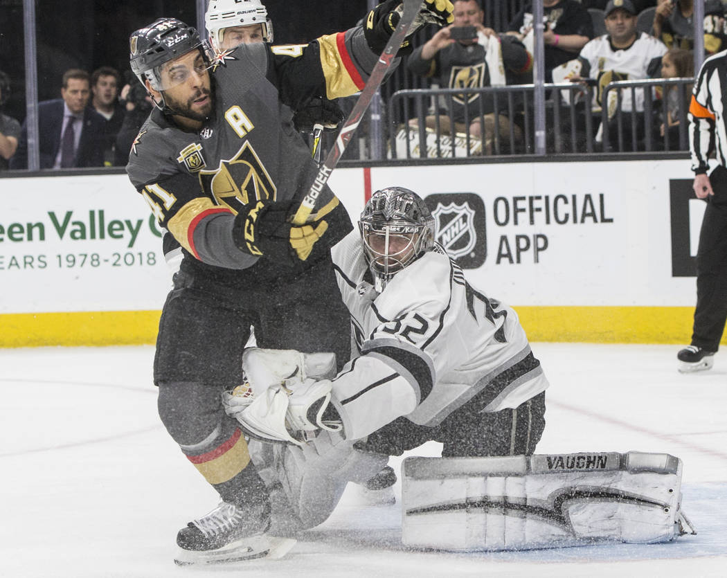Golden Knights right wing Pierre-Edouard Bellemare (41) collides with Los Angeles Kings goaltender Jonathan Quick (32) in the first period of game two of their first-round playoff series on Friday ...