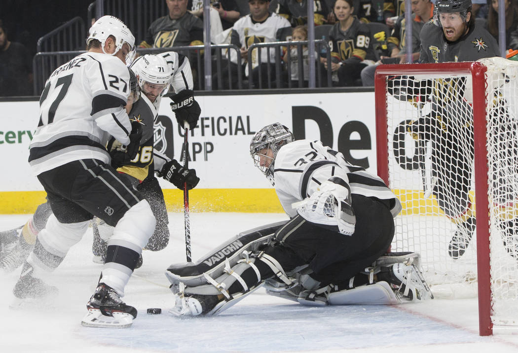 Los Angeles Kings goaltender Jonathan Quick (32) makes a save in the first period of game two of their first-round playoff series with Las Vegas on Friday, April 13, 2018, at T-Mobile Arena, in La ...